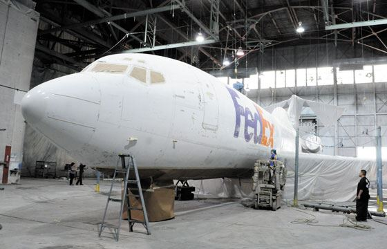 plane being painted inside dean baldwin