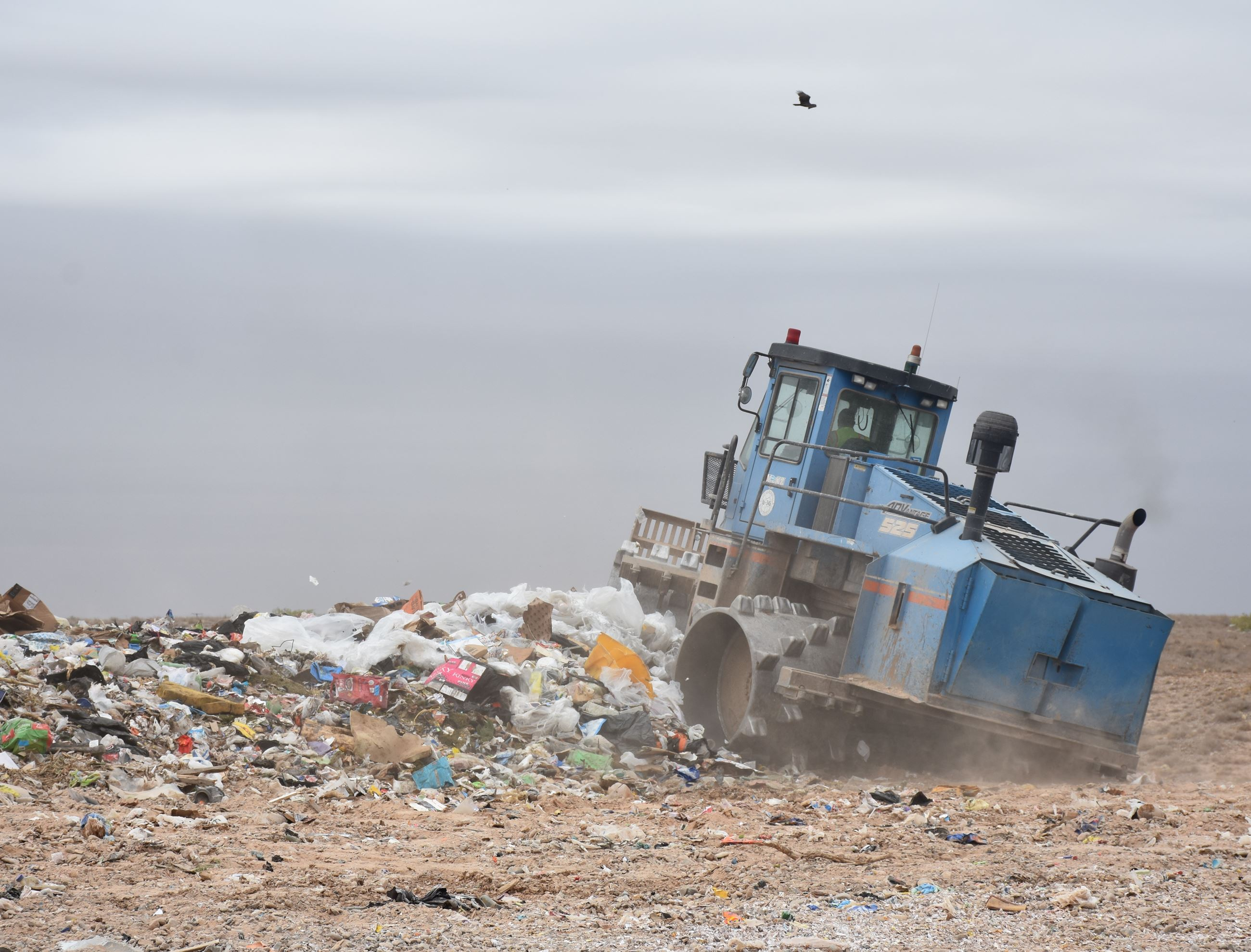 Photo of employee compacting trash