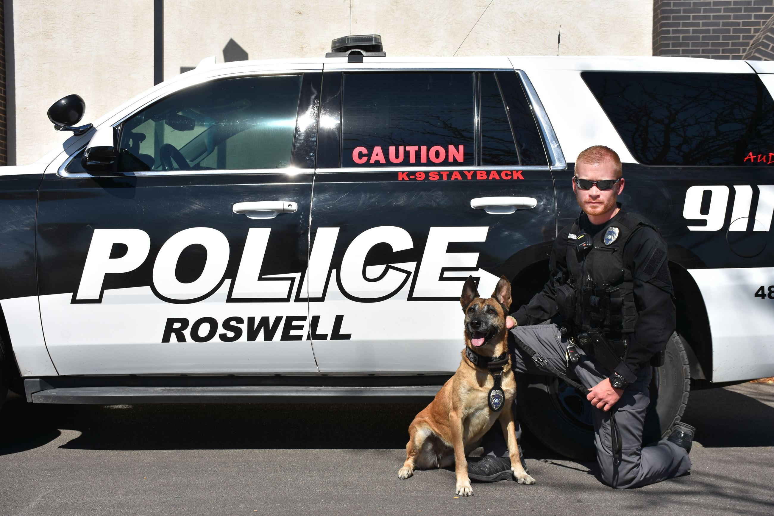 Photo of officer and K9