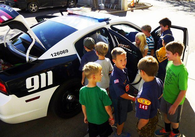 Boys and Girls Looking at Police Car