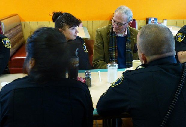 Community Members Interacting at Coffee with a Cop