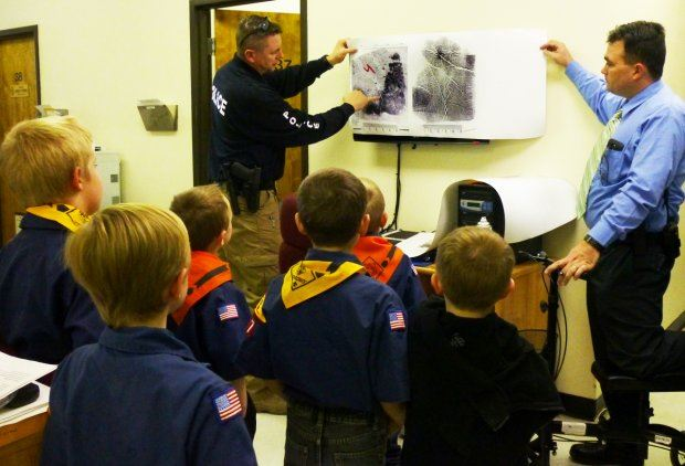 Officers Showing Scouts Fingerprints