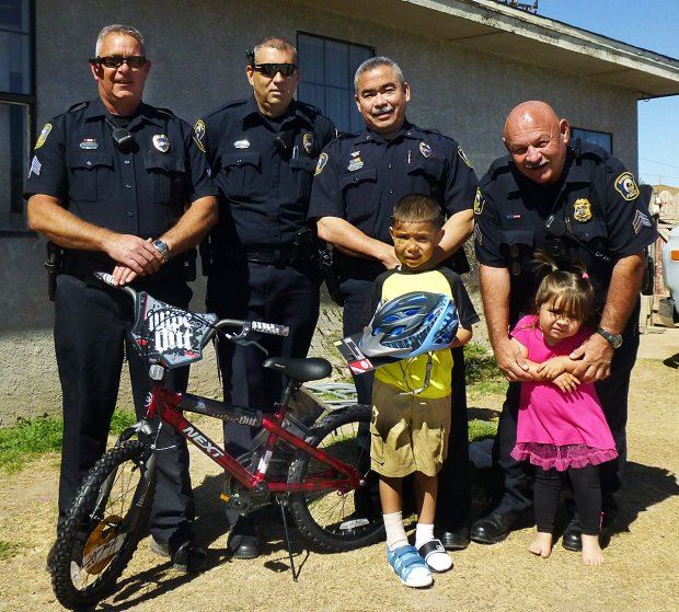 Officers with Two Young Children and Bicycle