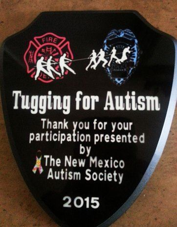 Tugging for Autism Sign