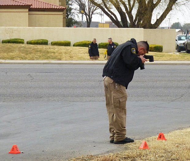 Officer Photographing Shooting Scene