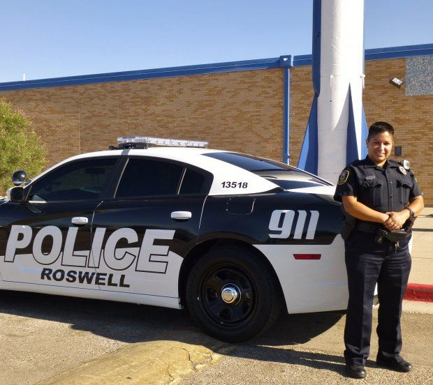 Officer Posing with Car