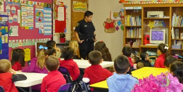 SRO Officer Cheromiah Speaks with Children