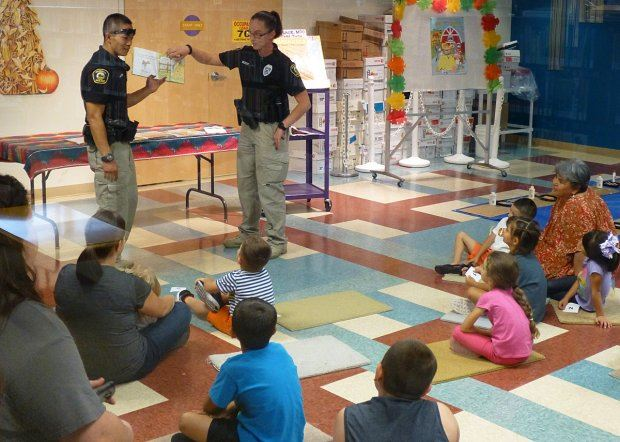 Two Officers Reading to a Class